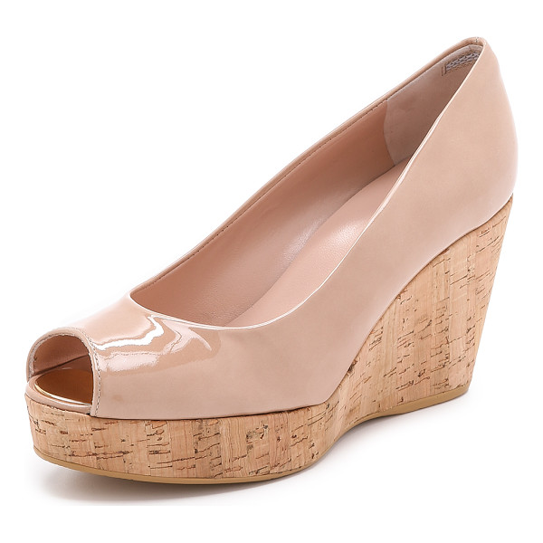 STUART WEITZMAN Anna peep toe wedges - A cork wedge and platform bring natural beauty to these