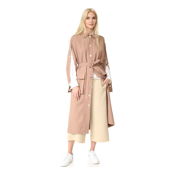 TIBI trench coat - Large brushed snaps run down the placket and split dolman...