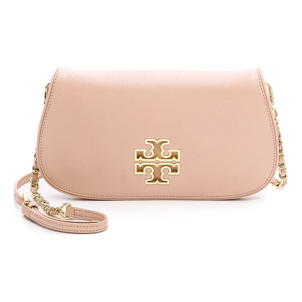 TORY BURCH Britten clutch - A gold tone cutout accents the front of this leather Tory
