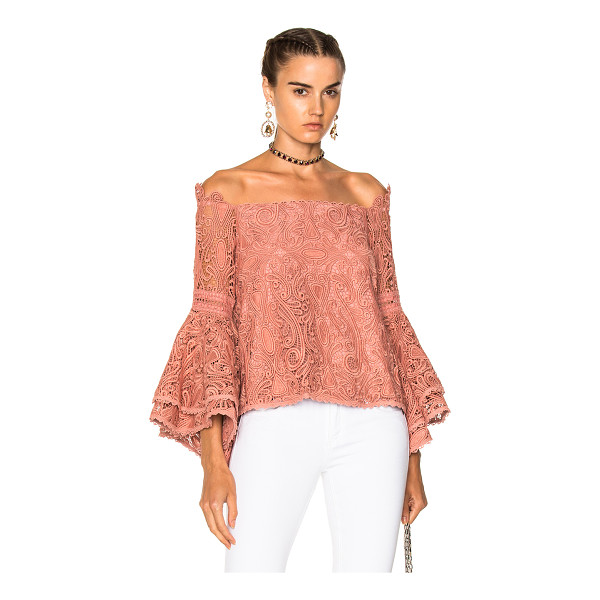 ALEXIS Thea Top - Self: 100% polyLining: 95% poly 5% spandex. Made in China....
