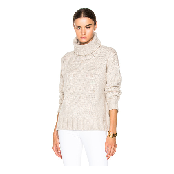 NILI LOTAN Turtleneck sweater - 55% wool 23% yak 22% nylon.  Made in China.  Knit fabric. ...