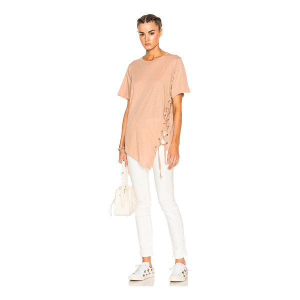 NSF Finley Tee - 100% cotton.  Made in USA.  Machine wash.  Side lace up...