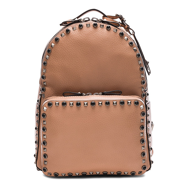 VALENTINO Guitar Rockstud Rolling Medium Backpack - Grained leather with raw lining and antique hardware. Made...