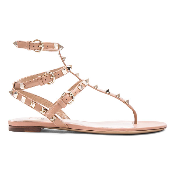 VALENTINO Leather rockstud flat sandals - Leather upper and sole.  Made in Italy.  Rubber tap heel. ...