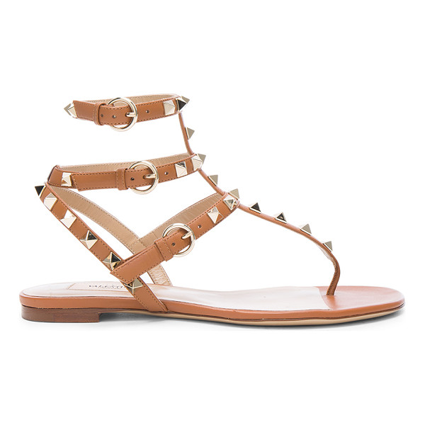 VALENTINO Leather Rockstud Gladiator Sandals - Leather upper and sole.  Made in Italy.  Rubber tap heel. ...