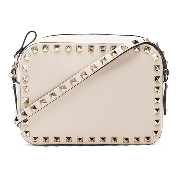 VALENTINO Rockstud Crossbody Bag - Genuine leather with canvas lining and gold-tone hardware. ...