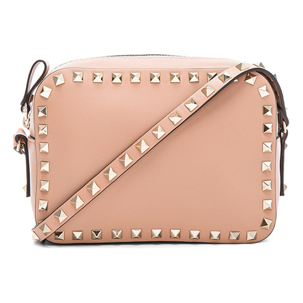 VALENTINO Rockstud Crossbody Bag - Genuine leather with canvas lining and gold-tone hardware.
