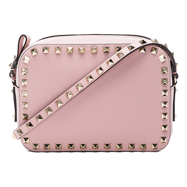 VALENTINO Rockstud Crossbody Bag - Genuine leather with canvas lining and gold-tone hardware....
