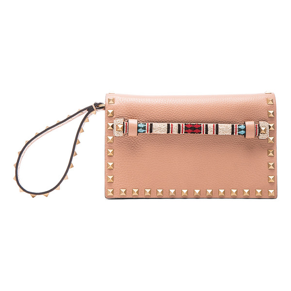 VALENTINO Small rockstud clutch - Genuine leather with raw lining and gold-tone hardware. ...