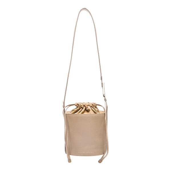 VICTORIA BECKHAM Bucket bag - Calfskin leather and suede with fabric lining and gold-tone...