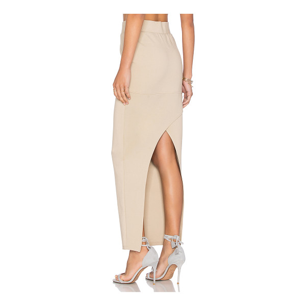 AGAIN Angie Skirt - Poly blend. Dry clean only. Unlined. Elastic waist....