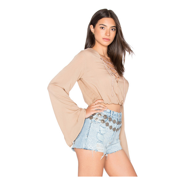 AILA BLUE Palm Crop Top - 100% rayon. Hand wash cold. Lace-up front detail. Elastic...