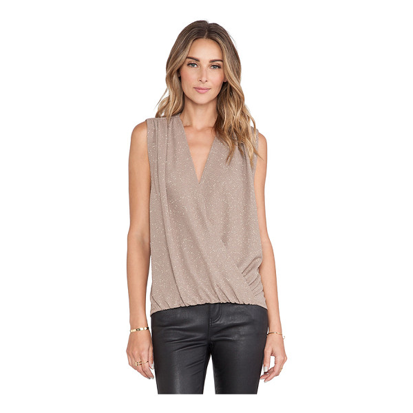 ALICE + OLIVIA Lilah cross over blouse - 95% poly 5% spandex. Dry clean only. Twist wrap front....
