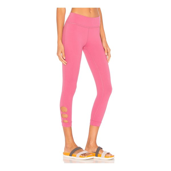 BEYOND YOGA Full Circle Cut Out Capri Legging - 90% supplex 10% lycra. Stretch fit. Side cut-outs at leg...