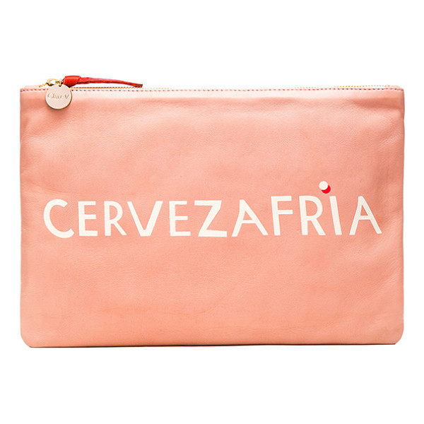 CLARE V. Flat Clutch - Leather exterior with denim fabric lining. Zip top closure....