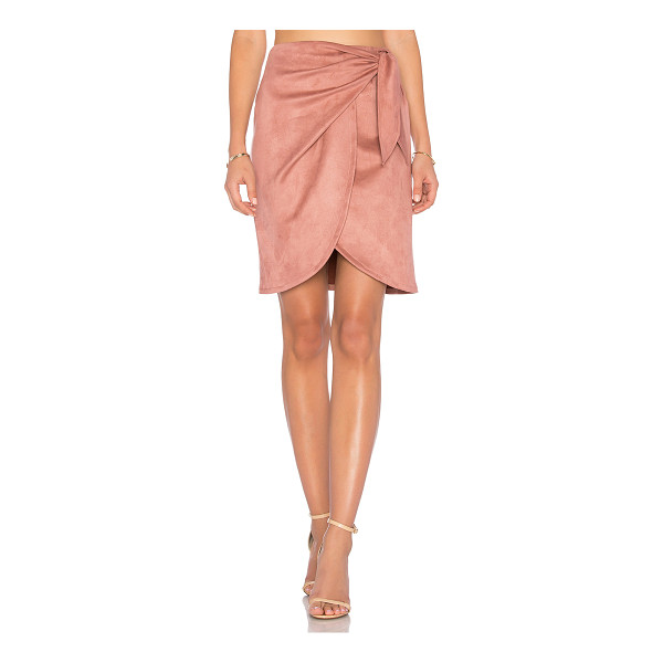 "DONNA MIZANI Leona Skirt - ""90% nylon 10% spandex. Dry clean only. Unlined. Wrap front..."