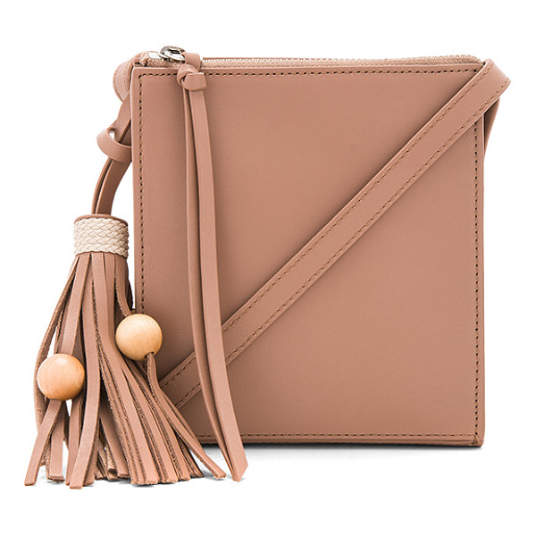 ELIZABETH AND JAMES Sara Crossbody - Leather exterior with nylon fabric lining. Zip top closure.
