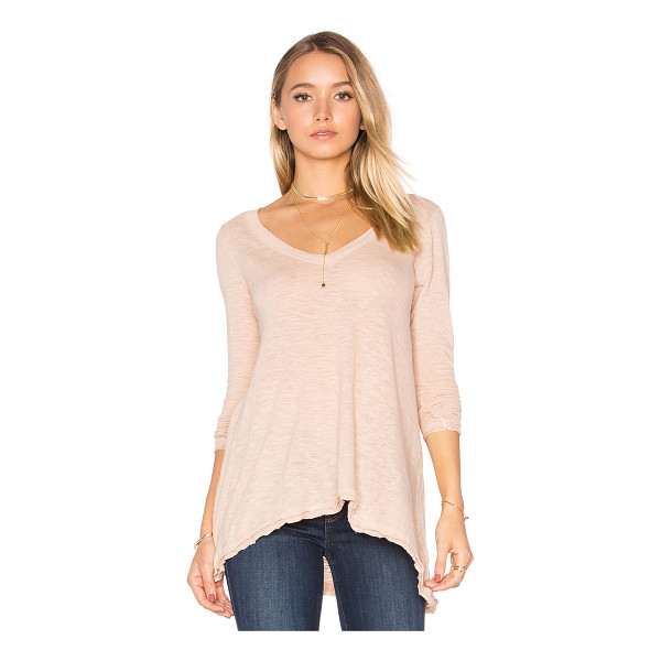 FREE PEOPLE Anna Tee - 100% cotton. Slub knit fabric. Raw cut asymmetrical hem....