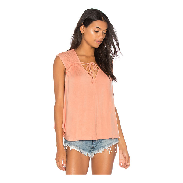 FREE PEOPLE Back In Town Top - 94% rayon 6% spandex. Shirred neckline detail with tie...