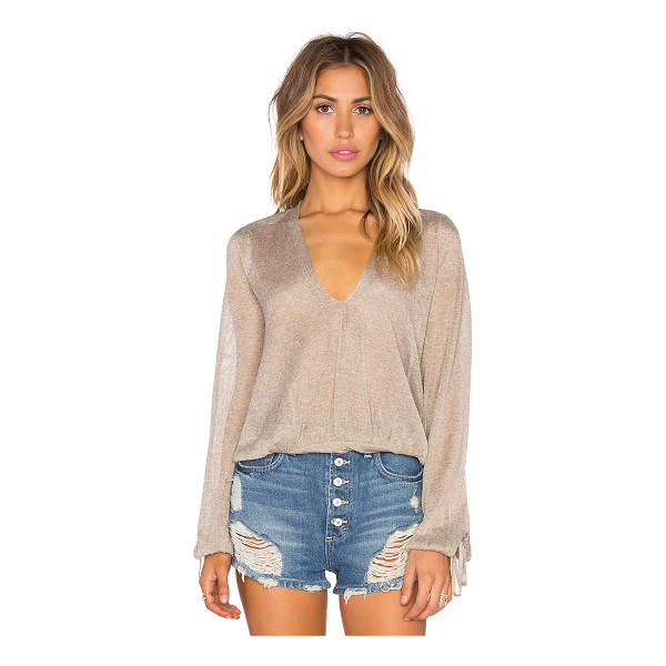 FREE PEOPLE Rock steady top - 52% viscose 48% poly. Hand wash cold. Drawstring sleeve...