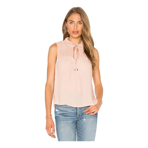 FREE PEOPLE Ruffle Me Up Top - 100% poly. Smocked shoulder panel. Front button with tie...