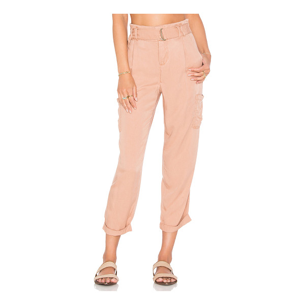 FREE PEOPLE Soft cargo pant - 100% rayon. Button fly. Elastic belted waist. Side slit...