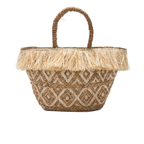 KAYU Lilian Tote - Woven straw exterior with fabric lining. Drawstring top...