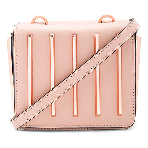 KENDALL + KYLIE Baxter Crossbody Bag - Leather exterior with suede lining. Double flap tops with