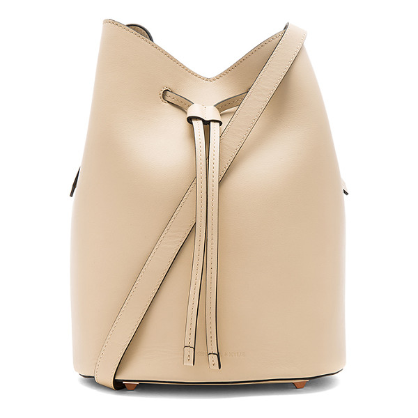 KENDALL + KYLIE Ladie Bucket Bag - Leather exterior and lining. Drawstring top closure....