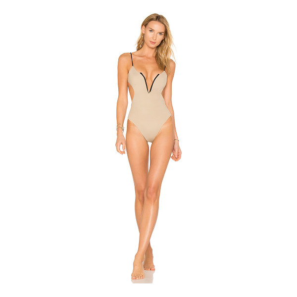 KOA Reversible Golden One Piece - 82% nylon 18% spandex. Hand wash cold. Stretch fit....