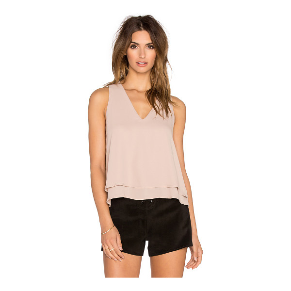 KRISA Open back tank - 100% poly. Back keyhole with button closure. Tiered flyaway...