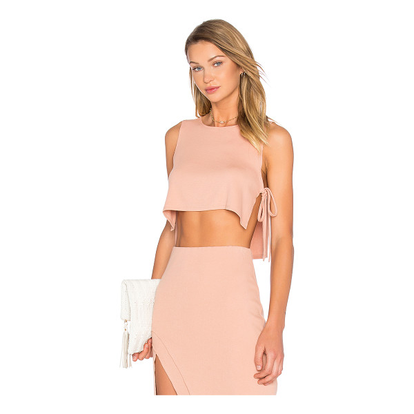 LOVERS + FRIENDS x REVOLVE Kisses Top - Cotton blend. Hand wash cold. Side slits with tie closure....