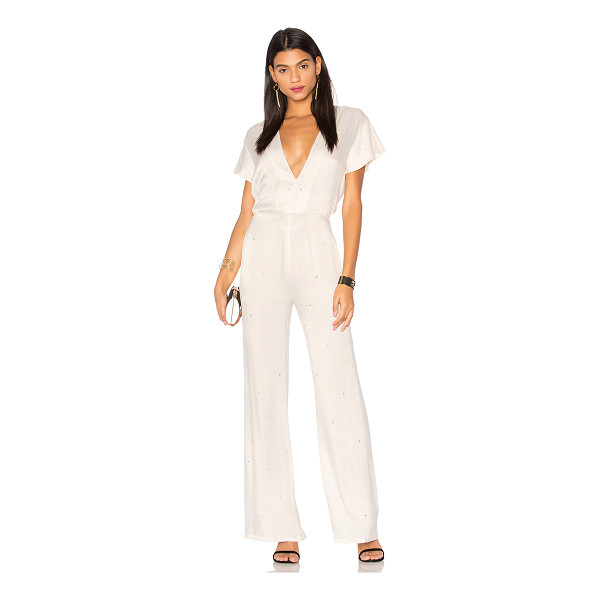 LPA Jumpsuit 94 - Glamourous meets girly in LPA's Jumpsuit 94. Studded with...