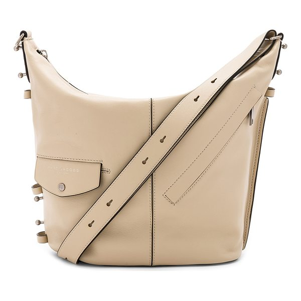 "MARC JACOBS The Sling Bag - ""Leather exterior with nylon fabric lining. Zip top..."
