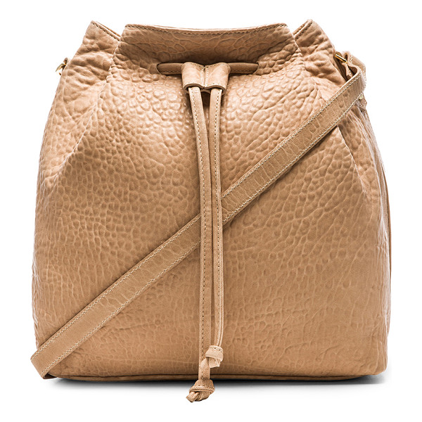 MR. Baker bucket crossbody rose - Leather exterior with poly fabric lining. Measures approx...
