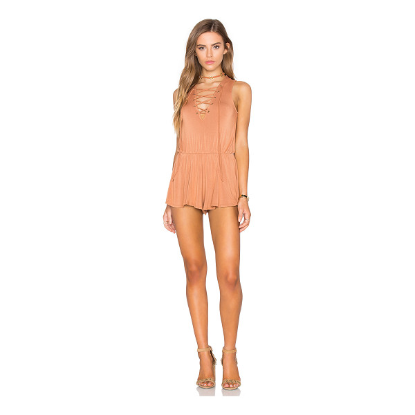 NYTT Nuri Romper - 95% rayon 5% spandex. Hand wash cold. Front lace-up tie...