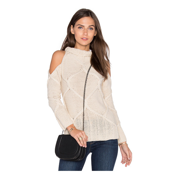 ROI Cold Shoulder Cable Sweater - 60% cotton 40% acrylic. Dry clean only. Open shoulders....