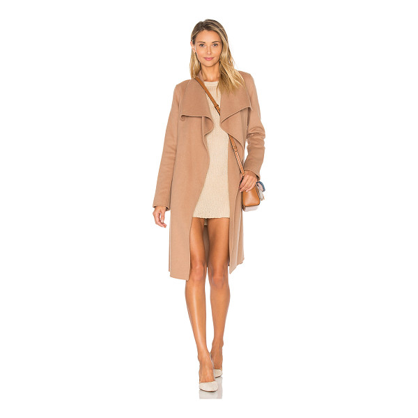 SOIA & KYO Oxana Coat - 53% wool 39% poly 4% rayon 4% other fibers. Dry clean only....