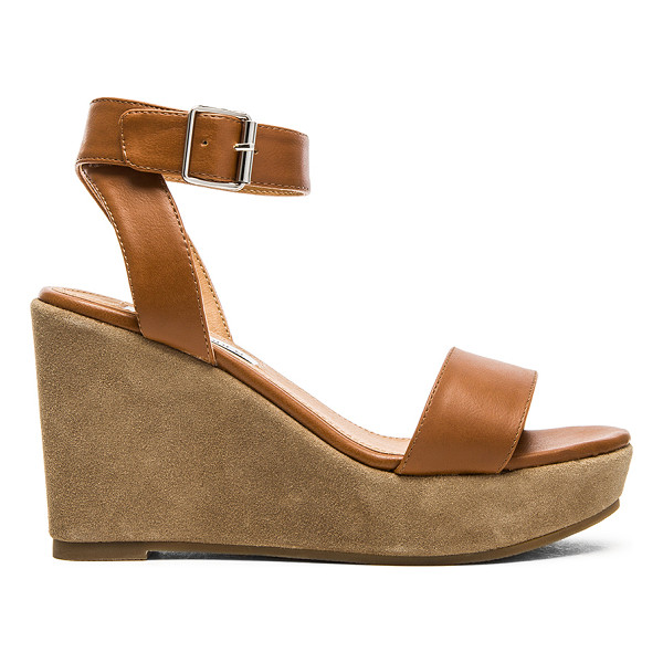 STEVE MADDEN Stryke sandal - Faux leather upper with rubber sole. Wedge measures approx...