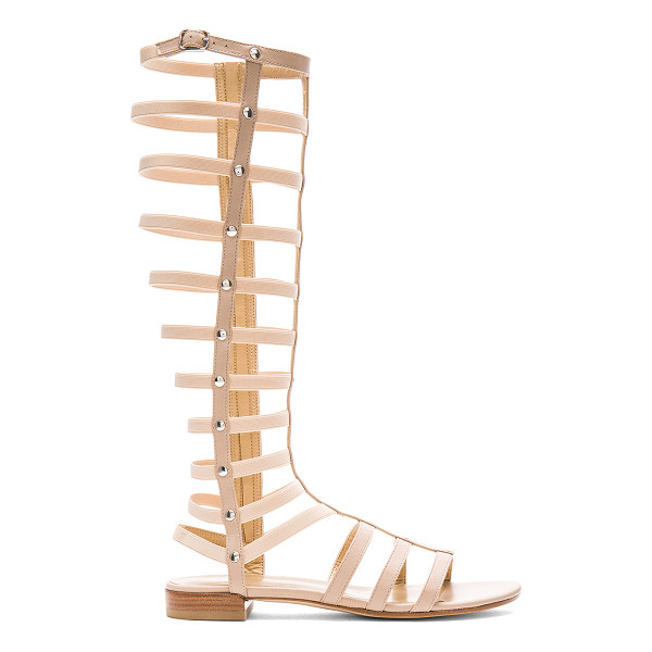 STUART WEITZMAN Gladiator Sandal - Leather upper and sole. Buckle accent. Elastic stretch...
