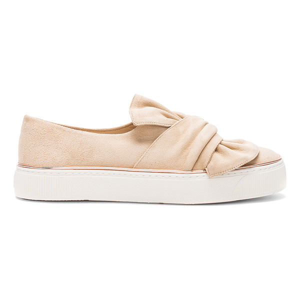 STUART WEITZMAN Twisteze Sneaker - Suede upper with rubber sole. Lace-up front. Bow accent at...