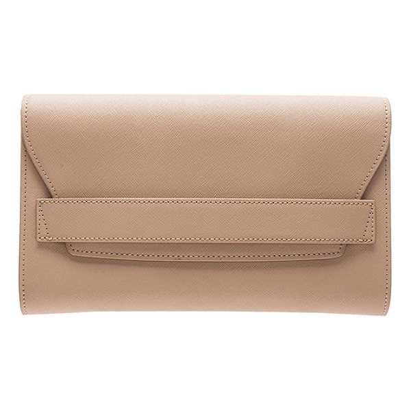 THE DAILY EDITED Fold Clutch - Leather exterior with nylon fabric lining. Flap top with...