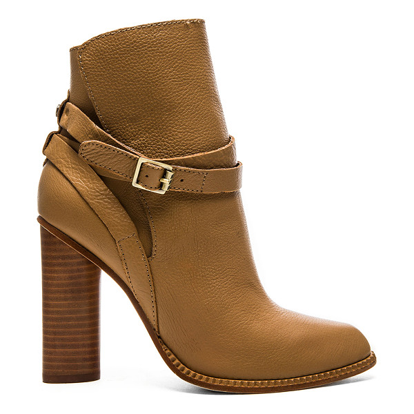 TWELFTH ST. BY CYNTHIA VINCENT Hue bootie - Leather upper and sole. Wrap detail with buckle closure....