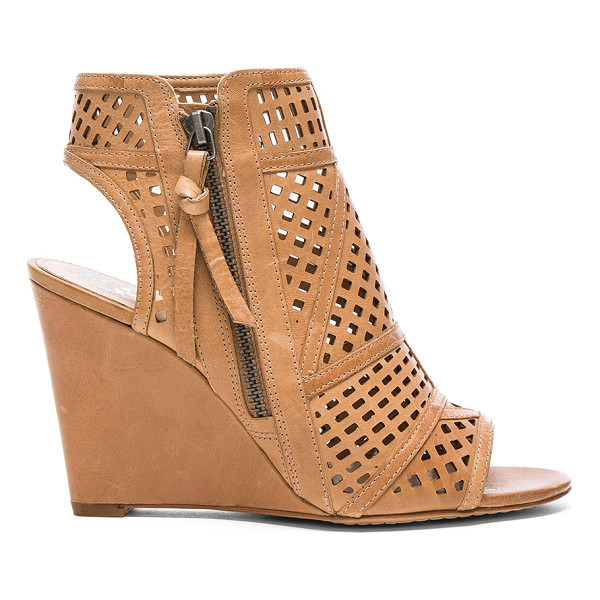 VINCE CAMUTO Xabrina Wedge - Leather upper with man made sole. Side zip closure. Laser...