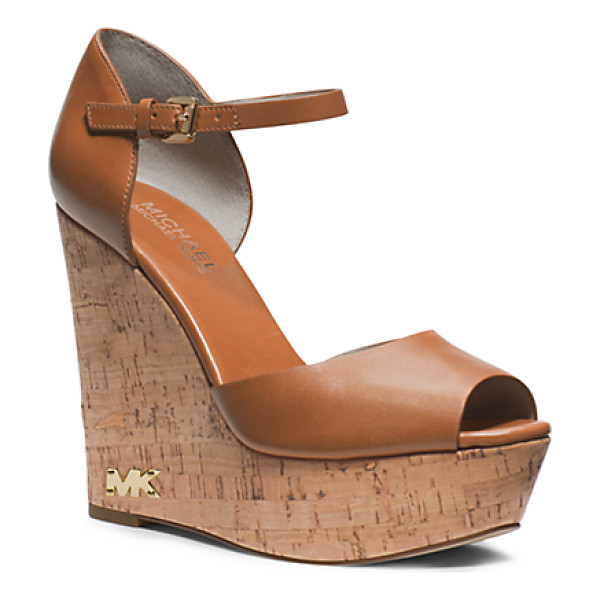 MICHAEL KORS Ivana Leather And Cork Wedge - The Sky's The Limit With Our Ivana Wedges A Vachetta...