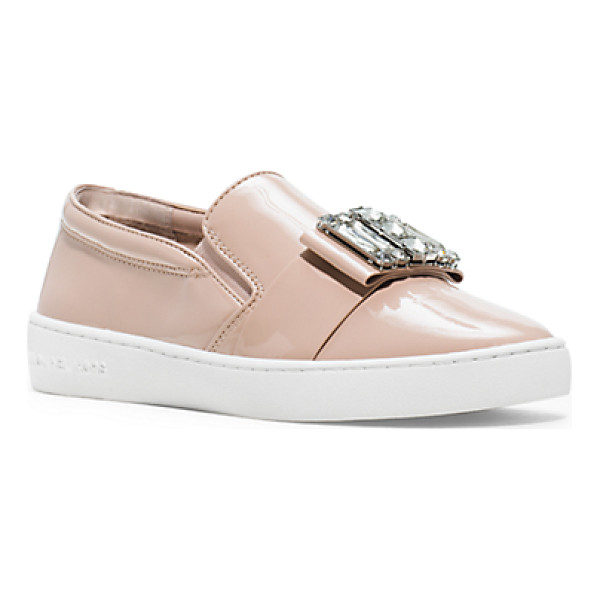 MICHAEL KORS Michelle patent-leather sneaker - A bejeweled go-to. Featuring a smart bow that's embellished...