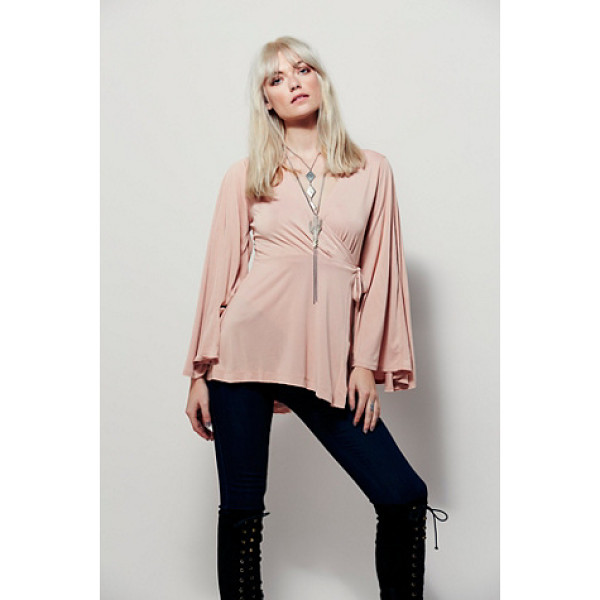 FREE PEOPLE Dynasty top - Semi sheer wrap top featuring a surplice style V-neckline...