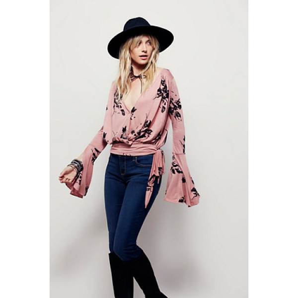 FREE PEOPLE Fiona top - Effortless V-neck top with surplice detailing and side tie...