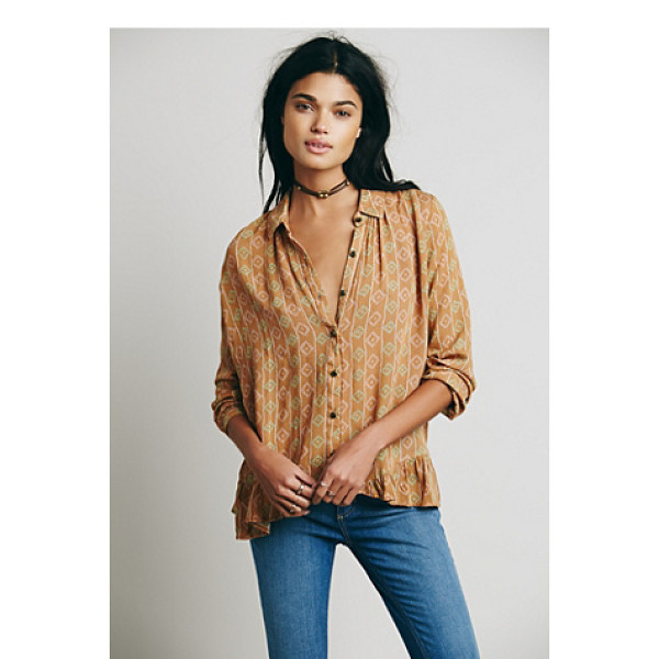 FREE PEOPLE Stripe ruffle hem button down - Our signature long-sleeved button down crepe blouse done in...