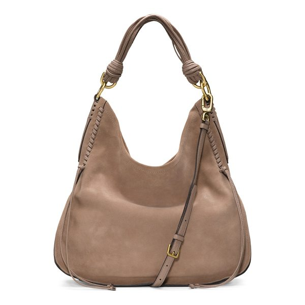 STUART WEITZMAN Laela - This haute hobo style is crafted from supple leather for a...